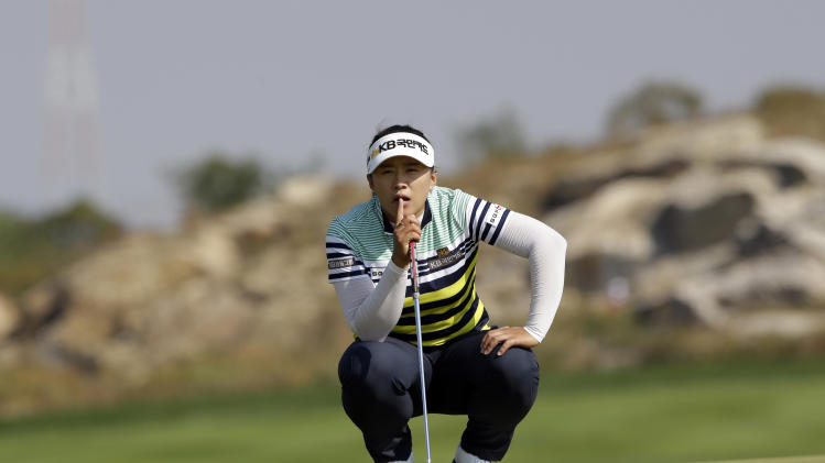 Amy Yang of South Korea lines up a putt on the sixth hole during the final round of the KEB Hana Bank Championship golf tournament at Sky72 Golf Club in Incheon, west of Seoul, South Korea, Sunday, Oct. 20, 2013. (AP Photo/Lee Jin-man)