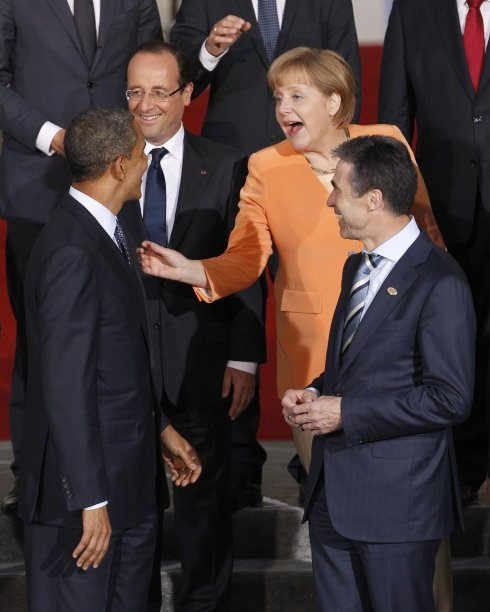 German Chancellor Angela Merkel gestures to U.S. President Barack Obama during a family photo of NATO heads of state in Chicago