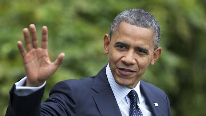 President Barack Obama waves as he leaves the White House in Washington for a campaign trip to Los Angeles, Calif., Sunday, Oct. 7, 2012.  (AP Photo/Manuel Balce Ceneta)