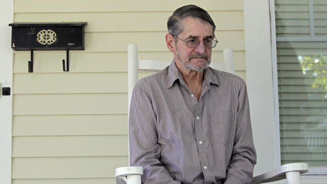 In this Wednesday, Oct. 24, 2012 photo, Thomas J. Menghi Jr. sits on the front porch of his home during an interview in Monroe, N.C. The former scoutmaster in North Carolina admits he molested as many as 10 boys in the early 1970s. Menghi was just one of thousands of former scout leaders named in secret files on suspected abusers kept by the Boy Scouts of America and released in mid-October 2012 under a court order. (AP Photo/Chuck Burton)