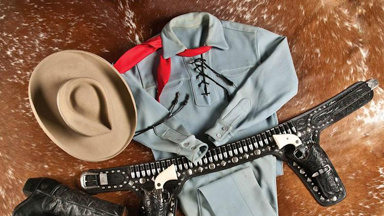 "This photo provided by A & S Auction Company of Waco, Texas shows the outfit Lone Ranger actor Clayton Moore wore when he made appearances as the character after retiring from television. A & S Auction Co. will offer up the items for auction on Saturday, July 12, 2014. Moore, who died in 1999, played the masked lawman on the ABC television series ""The Lone Ranger"" from 1949 to 1957. (AP Photo/A & S Auction Co.)"