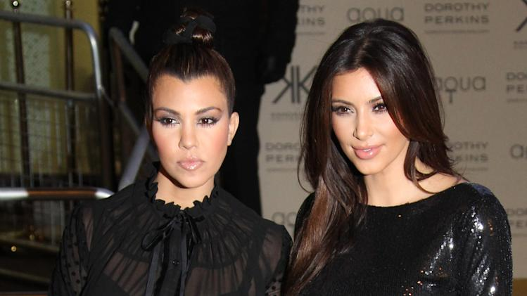 Kim, right, and Kourtney Kardashian arrive for their Kardashian Kollection UK Launch at Acqua Club in central London, Thursday, Nov. 8, 2012. (Photo by Joel Ryan/Invision/AP)