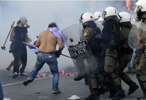 Protesting taxi drivers confront riot police during a demo in Thessaloniki on Saturday Sept. 10, 2011. Thousands of angry Greeks, from unionists fed up with some 20 months of austerity to local soccer fans, have called a series of protests in the country's second-largest city, ahead of an annual speech on the economy by Prime Minister George Papandreou. (AP Photo/Nikolas Giakoumidis)
