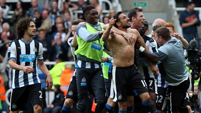 Newcastle United's Jonas Gutierez, center, celebrates his goal with his teammates during the  English Premier League soccer match between Newcastle United and West Ham United's  at St James' Park, Newcastle, England, Sunday, May 24, 2015. (AP Photo/Scott Heppell)