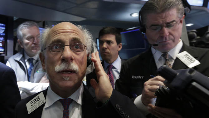 Trader Peter Tuchman, left, works on the floor of the New York Stock Exchange Friday, April 19, 2013. The broad Standard & Poor's 500 index opened higher early Friday.  (AP Photo/Richard Drew)