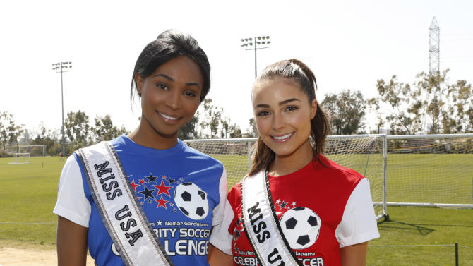 Miss USA Nana Meriwether and Miss Universe Oliiva Culpo attend the LAFEST LA Film and Entertainment Soccer Tournament, on Sunday, March 24, 2013 in Carson, California. (Photo by Todd Williamson/Invision for THR/AP Images)