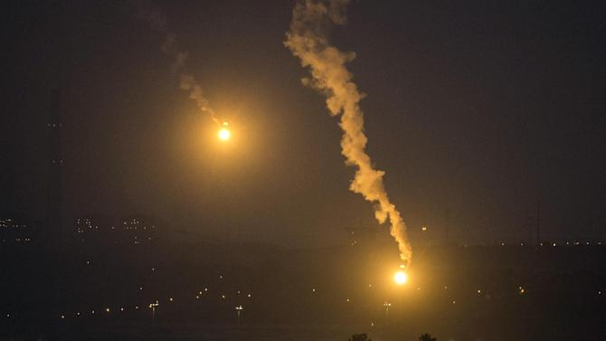 A picture taken from the Israeli Gaza border shows an Israeli army flare illuminating the sky above the Gaza strip on July 17, 2014