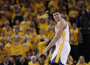 Golden State Warriors' Andrew Bogut reacts during their loss to the San Antonio Spurs in their NBA Western Conference semi-final playoff basketball game in Oakland