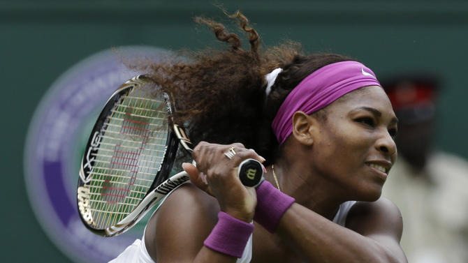 Serena Williams of the United States plays a return to Zheng Jie of China during a third round women's singles match at the All England Lawn Tennis Championships at Wimbledon, England, Saturday, June 30, 2012. (AP Photo/Anja Niedringhaus)