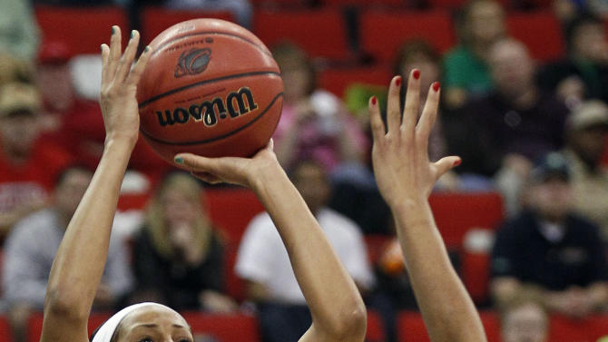 FILE - In this March 27, 2012, file photo, Notre Dame's Skylar Diggins (4) shoots over Maryland's Tianna Hawkins (21) during the second half of an NCAA women's tournament regional final college basketball game in Raleigh, N.C. Diggins was a unanimous choice to join The Associated Press' women's basketball preseason All-America team, receiving all 40 votes from a national media panel Tuesday, Oct. 30. (AP Photo/Gerry Broome, File)