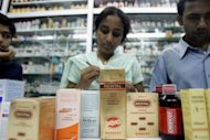 Indian staff check batch numbers of Ranbaxy medicines at a shop in Mumbai in 2008. Indian pharmaceutical giant Ranbaxy on Wednesday reported quarterly net profit jumped more than four-fold on-year as performance was boosted by sales of its new copycat cholesterol-busting drug
