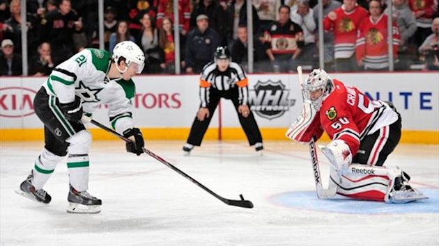 Dallas Stars left wing Antoine Roussel (21) scores a goal on a penalty shot against Chicago Blackhawks goalie Corey Crawford (50) (Reuters)