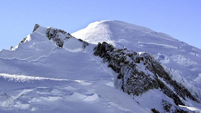 FILE - This Feb. 19, 2003 file photo shows Mont Blanc, western Europe's highest mountain. A mayor in the French Alps says five climbers have died on Mont Blanc and a sixth is missing. The climbers disappeared overnight as they were trying to reach the Aiguille d'Argentiere, which tops out around 3,900 meters (12,800 feet). Mont Blanc, in addition to its primary peak, contains some 200 summits. The bodies of five climbers were located Wednesday, Aug. 13, 2014, while a sixth has not been found, said Jean-Marc Peillex, mayor of Saint-Gervais, a town at the foot of Europe's tallest mountain. (AP Photo/Patrick Gardin, File)