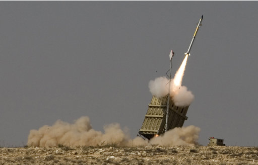 A rocket is launched from a new Israeli anti-missile system known as Iron Dome in order to intercept a rocket fired by Palestinian militants from the Gaza Strip, in the southern city of Beersheba, Israel, Sunday, Aug. 21, 2011. Militants in the Hamas-ruled Gaza Strip fired a barrage of rockets and mortars on southern Israel early Sunday, striking an empty school and a dozen other targets, as U.S. and Egyptian diplomats were scrambling to keep the new convulsion of Israeli-Palestinian violence from escalating. (AP Photo/Dan Balilty)