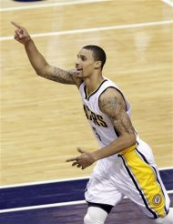 Indiana Pacers guard George Hill celebrates a basket late in the second half of Game 3 against the Miami Heat in their NBA basketball Eastern Conference semifinal playoff series in Indianapolis, Thursday, May 17, 2012. The Pacers won 94-75. (AP Photo/Michael Conroy)