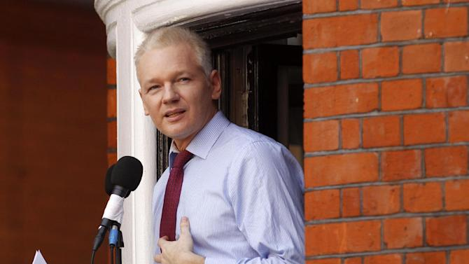 FILE - This Aug. 19, 2012 file photo shows WikiLeaks founder Julian Assange making a statement to the media and supporters at a window of Ecuadorian Embassy in central London. A news website says Assange regards his bid to become an Australian senator as a defense against potential criminal prosecution in the United States and Britain. He spoke to The Conversation website at the Ecuadorian Embassy in London where he was granted asylum in June to avoid extradition to Sweden on sex crime allegations. (AP Photo/Sang Tan, File)