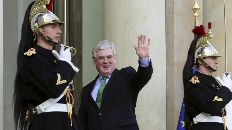 Ireland's Deputy PM Gilmore arrives to meet France's President Hollande at the Elysee Palace in Paris
