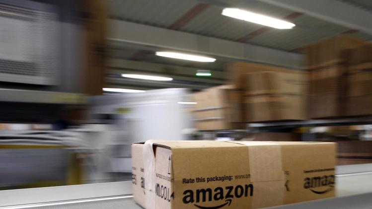 A parcel moves on the conveyor belt at Amazon's logistics centre in Graben in this file photo