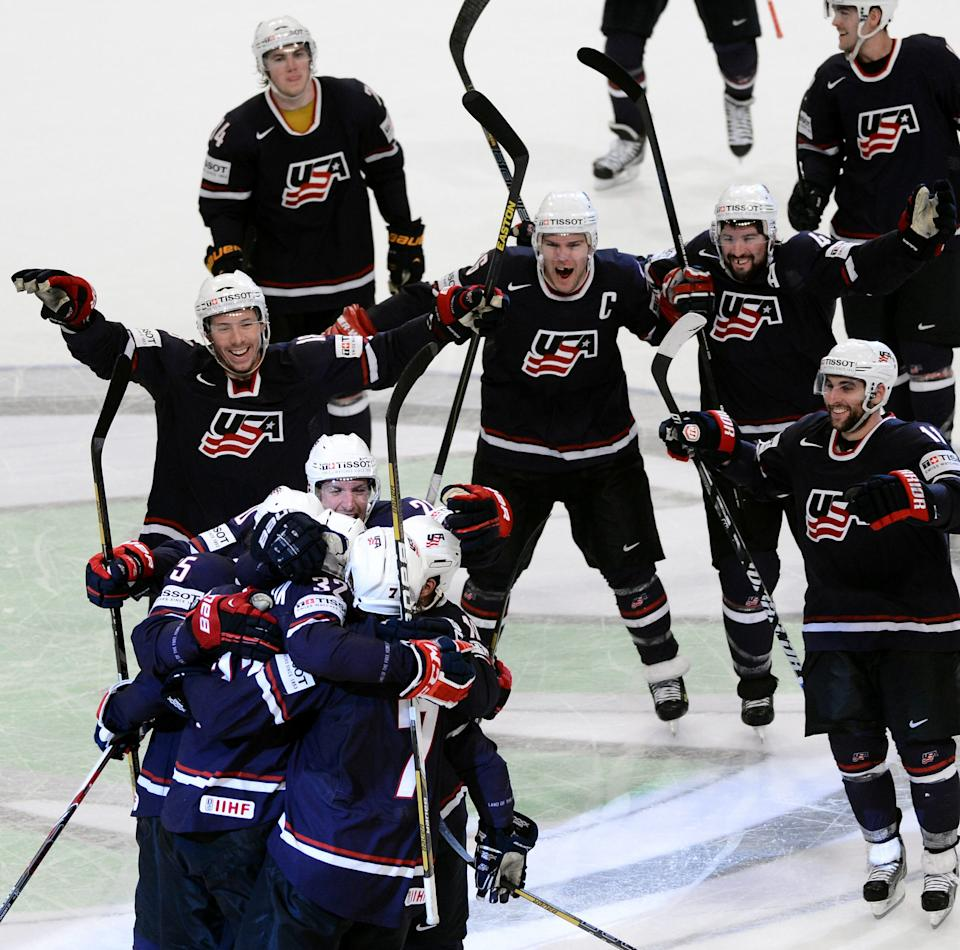 The US team celebrates winning the 2013 Ice Hockey IIHF World Championship bronze medal match between Finland and USA at the Globe Arena in Stockholm, Sweden, May 19, 2013.  (AP Photo/Scanpix Sweden/Fredrik Sandberg) SWEDEN OUT