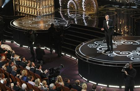Oscars host Seth MacFarlane speaks on stage at the start of the 85th Academy Awards in Hollywood, California February 24, 2013. REUTERS/Mario Anzuoni