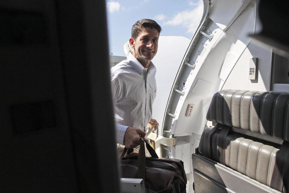 Republican vice presidential candidate, Rep. Paul Ryan, R-Wis. boards the campaign charter flight at the Clearwater International airport, Wednesday, Oct. 10, 2012, in Clearwater, Fla.  (AP Photo/Mary Altaffer)