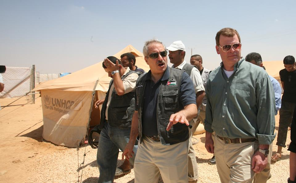 Jordanian Foriegn Minister Nasser Judeh  and his  Canadian counterpart  John Baird, right, visit the  Zaatari camp for Syrian refugees in Mafraq, Jordan, Saturday, Aug. 11, 2012.  (AP photo/Mohammad Hannon)