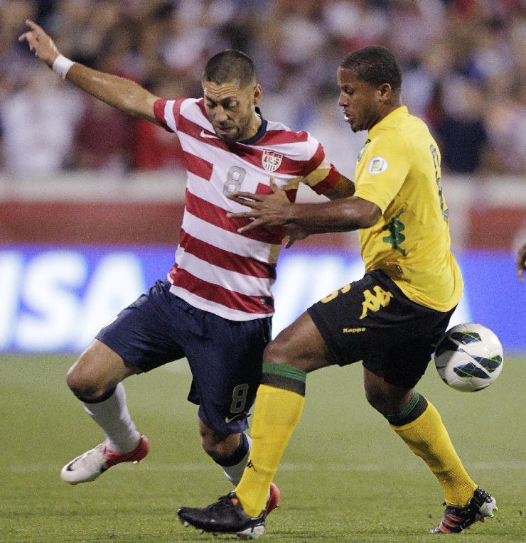 United States' Clint Dempsey, left, and Jamaica's Jermaine Taylor fight for a loose ball during the first half of a World Cup qualifying soccer match Tuesday, Sept. 11, 2012, in Columbus, Ohio. (AP Photo/Jay LaPrete)