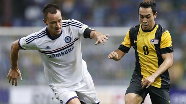"Malaysia's Norsharul Idlan Talaha (R) is challenged by Chelsea's John Terry during their friendly football match as part of Chelsea's ""Here To Play, Here To Stay, Asia Tour 2013 (Reuters)"
