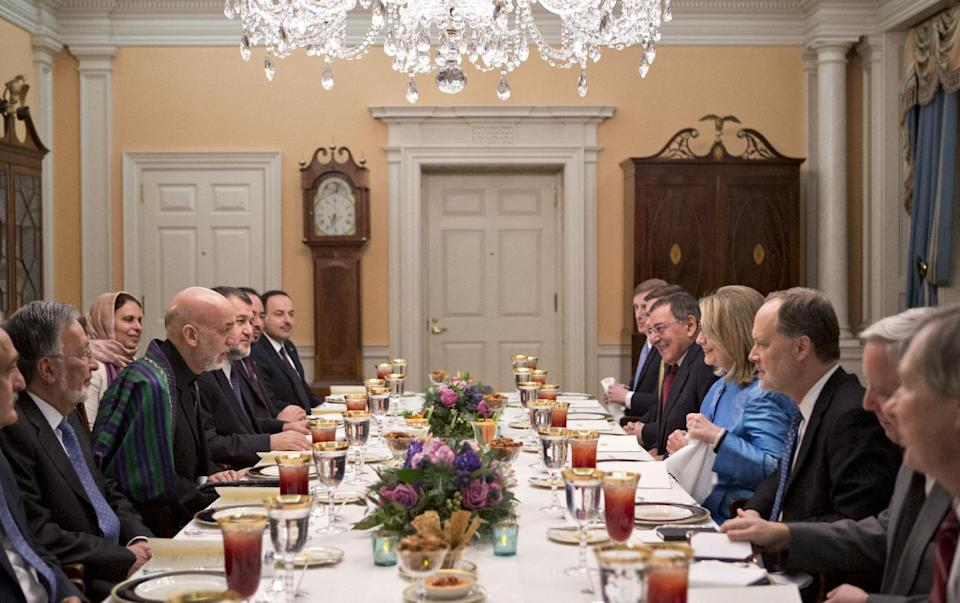 Secretary of State Hillary Rodham Clinton, on right side of table, dines with Afghanistan President Hamid Karzai, left, in a small room at the State Department in Washington, Thursday, Jan. 10, 2013. Defense Secretary Leon Panetta is seated next to Secretary Clinton. (AP Photo/J. Scott Applewhite)