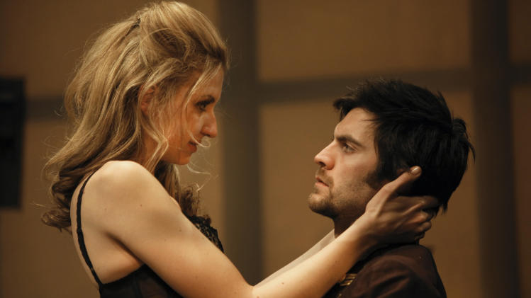 """In this theater publicity image released by The Publicity Office, Nina Arianda, left, and Wes Bentley are shown in a scene from David Ives' """"Venus in Fur,"""" playing off-Broadway at the Classic Stage Company in New York. The production was nominated for a Tony Award for best play, Tuesday, May 1, 2012. (AP Photo/The Publicity Office, Joan Marcus)"""