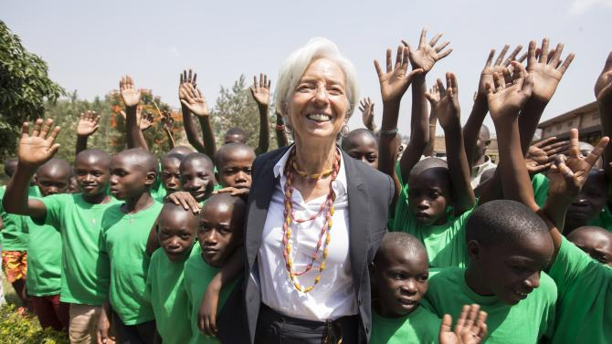 IMF Managing Director Lagarde poses with children after visiting at the Rugamba Center for street children school  in Kigali