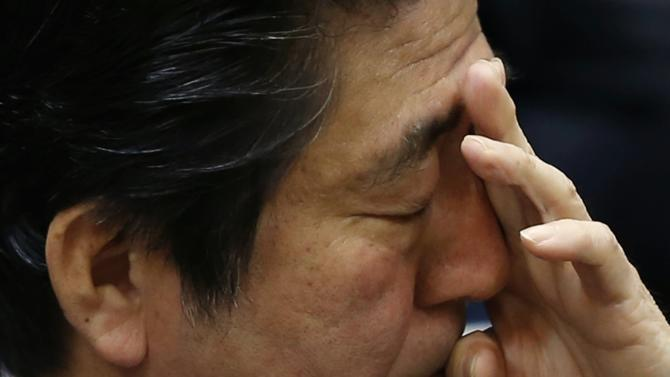Japan's PM Abe scratches face during upper house committee session at parliament in Tokyo