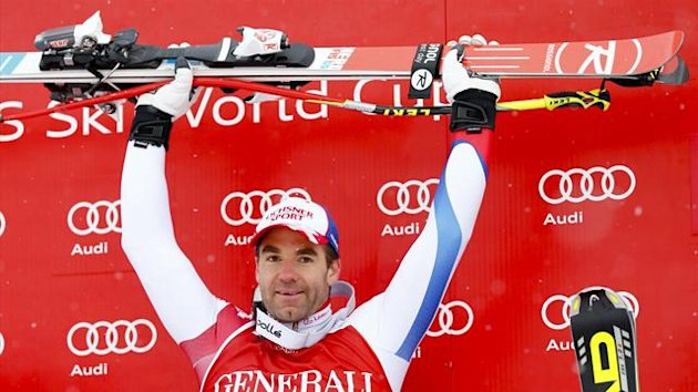 Didier Defago of Switzerland celebrates on the podium after winning the men's Super G of the FIS Alpine Skiing World Cup (Reuters)