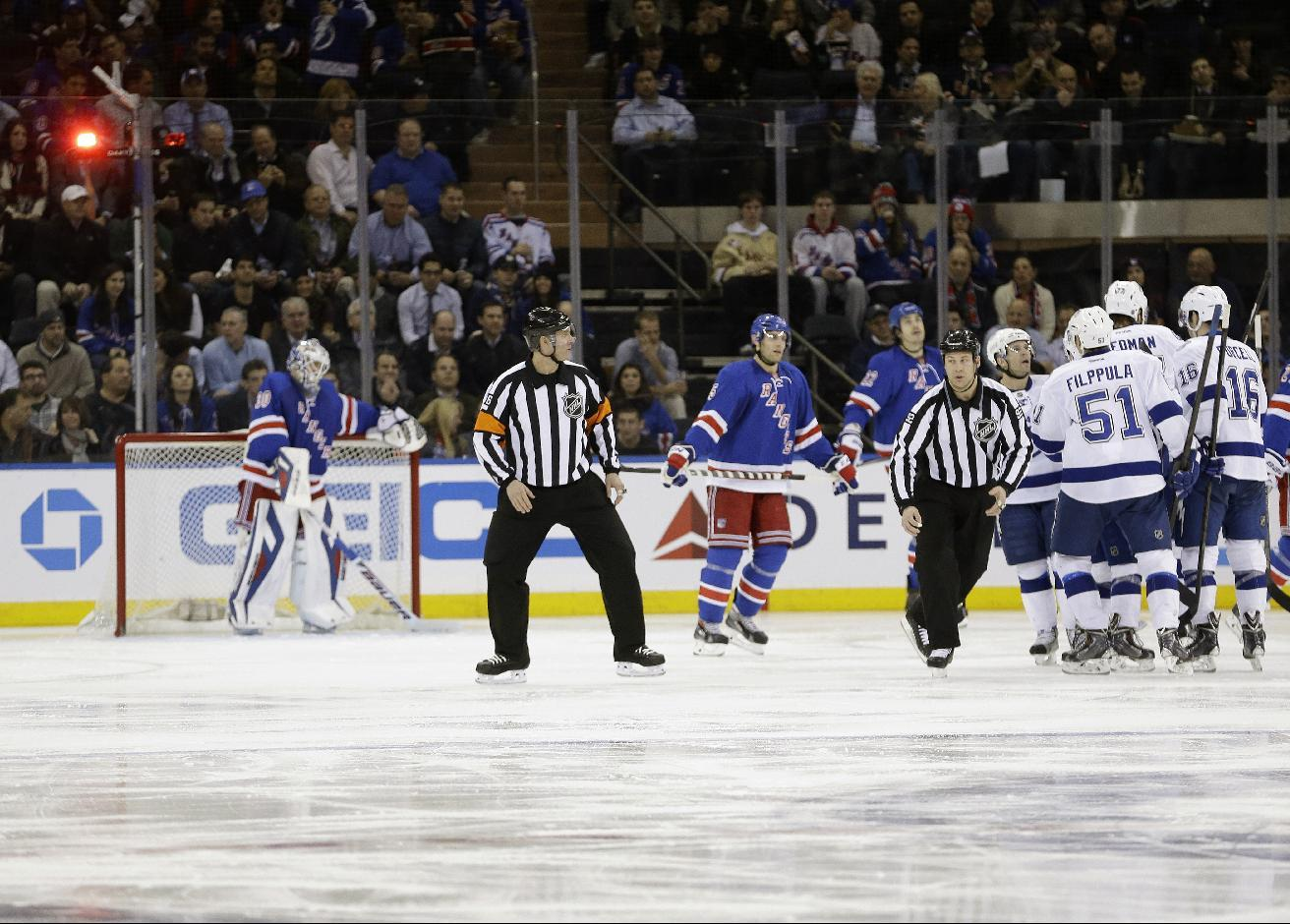 Tampa Bay Lightning celebrates a goal by Victor Hedman as New York Rangers goalie Henrik Lundqvist (30) reacts during the second period of an NHL hockey game, Tuesday, Jan. 14, 2014, in New York