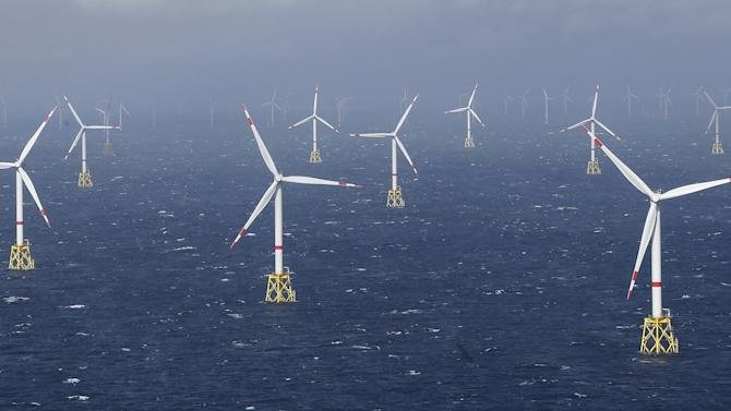 Power-generating windmill turbines are pictured at 'Amrum Bank West' offshore windpark in the northern sea near the island of Amrum