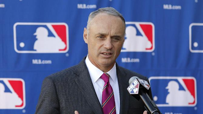 In a Jan. 15, 2015 file photo then Commissioner-elect Rob Manfred speaks during a news conference at the Major League Baseball owners meeting in Phoenix.   Monday morning, Jan. 26, 2015, was the first business day after Manfred succeeded Bud Selig and started a five-year term as commissioner