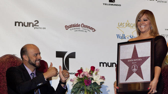 FILE .- I this July 1, 2011 file photo, singer Jenni Rivera, right, poses with a replica of a star for the Las Vegas Walk of Stars as her husband, former Major League Baseball pitcher Esteban Loaiza, reacts during an official presentation ceremony in Las Vegas. The wreckage of a small plane believed to be carrying Mexican-American music superstar Jenni Rivera was found in northern Mexico on Sunday, Dec. 9, 2012, and there are no apparent survivors, authorities said. (AP Photo/Julie Jacobson, File)