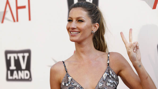 """FILE - In this June 9, 2011 file photo, Gisele Bundchen arrives at the taping of """"TV Land Presents: AFI Life Achievement Award Honoring Morgan Freeman"""" in Culver City, Calif. Bundchen, supermodel and wife of New England Patriots quarterback Tom Brady, was stopped for speeding over the weekend and given a verbal warning by a Massachusetts state trooper. (AP Photo/Matt Sayles, File)"""