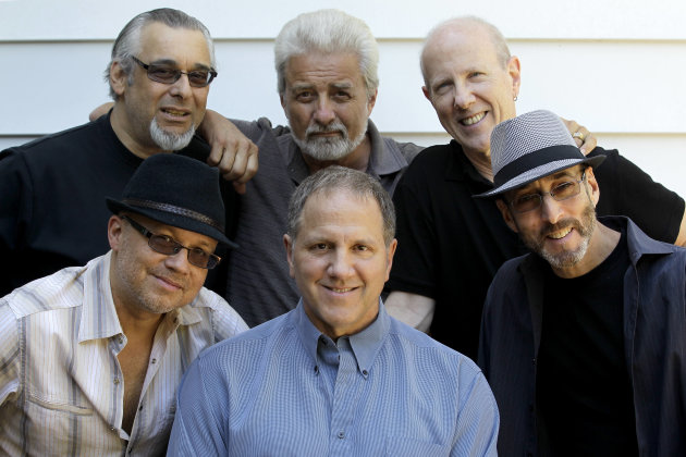 Members of the Four Seasons band, front from left: Russ Velasquez, Gary Polci, Larry Gates and rear from left Lee Shapiro, Don Ciccone and Jimmy Ryan pose for The Associated Press, Sunday, May 13, 2012 in Fair Lawn, N.J. Former members of the Four Seasons, minus lead singer Frankie Valli, have teamed up with some A-list studio musicians and have been rehearsing in Gates&#39; basement in preparation for a nationwide tour. (AP Photo/Julio Cortez)
