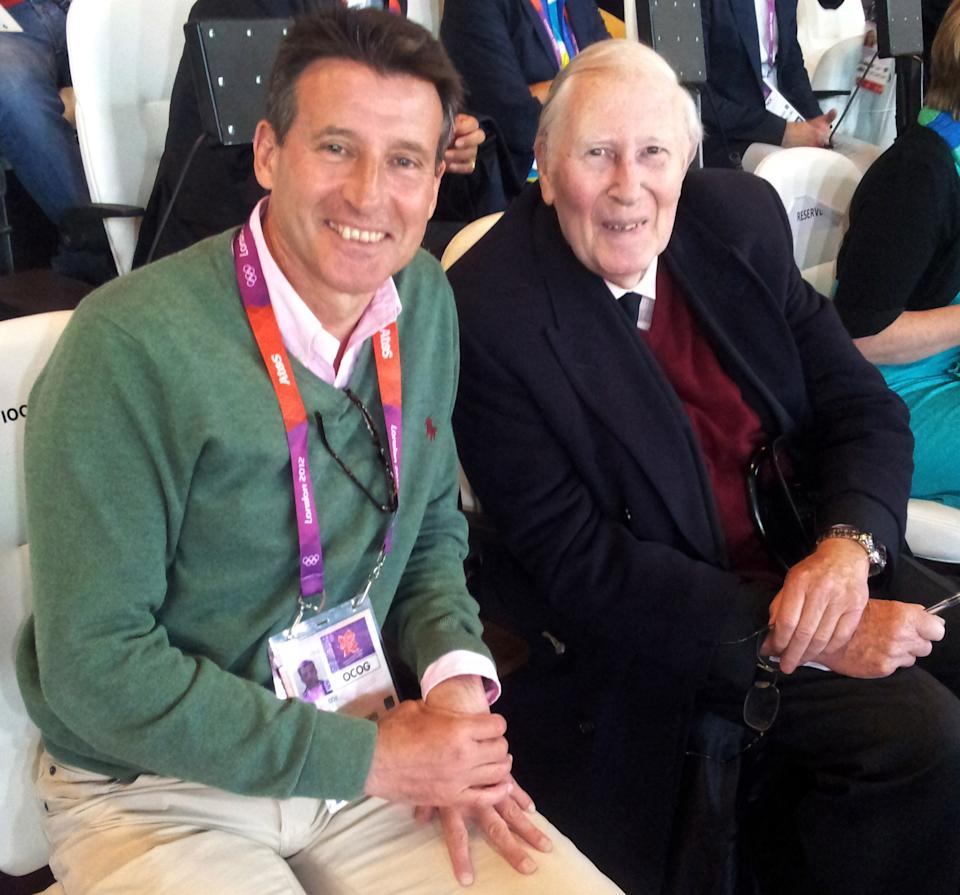 LOCOG Chairman Sebastian Coe, left, and running legend Roger Bannister watch the athletics competitions at the 2012 Summer Olympics, Wednesday, Aug. 8, 2012, in London. (AP Photo)