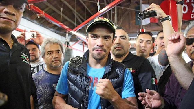Juan Manuel Marquez, of Mexico, poses in the ring during a media workout at a boxing club in Bell, Calif., Wednesday, May 14, 2014. He and Mike Alvarado are preparing for their WBO welterweight title elimination bout at the Forum in Inglewood, Calif., Saturday. The winner will become the mandatory challenger to WBO welterweight champion Manny Pacquiao