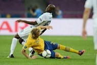 French midfielder Alou Diarra (L) vies with Swedish forward Ola Toivonen during the Euro 2012 football championships match Sweden vs France at the Olympic Stadium in Kiev. France qualified for the knockout stages of a major finals for the first time in six years here on Tuesday despite losing their final Euro 2012 Group D match 2-0 to already eliminated Sweden