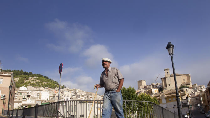 A man walks in Moratalla, a small agricultural center and rural tourism destination of just 8,500 people, in Spain, Thursday, Aug. 11, 2011. Moratalla, is one of the few towns in Spain that admits it's on the verge of going broke. None of the 120 municipal workers have been paid since June. (AP Photo/Alberto Saiz)