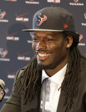 Houston Texans No. 1 overall NFL draft pick Jadeveon Clowney, a defensive end from South Carolina, is all smiles as he meets the press during an introductory NFL football news conference Friday, May 9, 2014, in Houston. (AP Photo/Pat Sullivan)