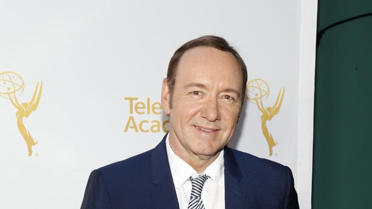 Spacey poses at the Television Academy's Performers Peer Group cocktail reception to celebrate the 66th Primetime Emmy Awards in Beverly Hills
