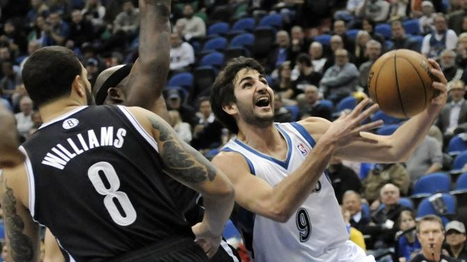 Minnesota Timberwolves' Ricky Rubio, right, of Spain, lays up past Brooklyn Nets' Deron Williams in the first half of an NBA basketball game on Wednesday, Jan. 23, 2013, in Minneapolis. (AP Photo/Jim Mone)