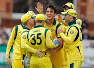 File photo shows Australia's Pat Cummins (3rd R) celebrating with his teammates during the first one-day international cricket match against England on June 29. Top-ranked Australia will play emerging cricket nation Afghanistan for the first time in a one-day international in the Middle East next month, Cricket Australia said on Monday