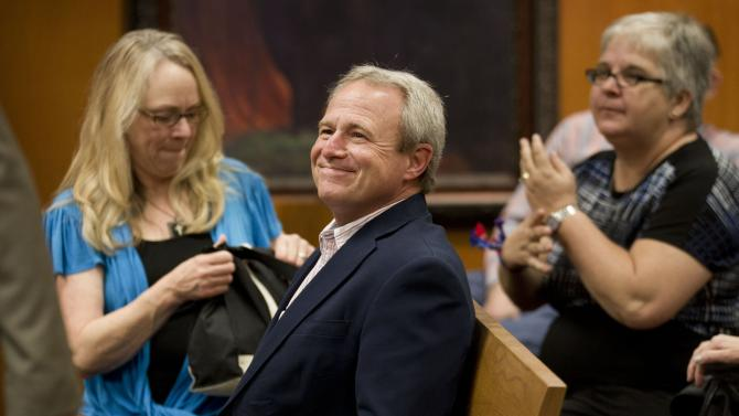 Michael Morton smiles before the start of the court of inquiry for Morton's prosecutor, Ken Anderson, at the Williamson County Courthouse in Georgetown, Texas on Thursday, Feb. 7, 2013. An attorney who defended Morton, who served nearly 25 years in prison for a wrongful murder conviction, is testifying in a special case to determine if prosecutorial misconduct led to the verdict. (AP Photo/Austin American-Statesman, Jay Janner, Pool)