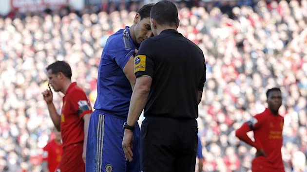 Chelsea's Branislav Ivanovic (L) shows his arm to referee Kevin Friend after an incident with Liverpool's Luis Suarez (Reuters)