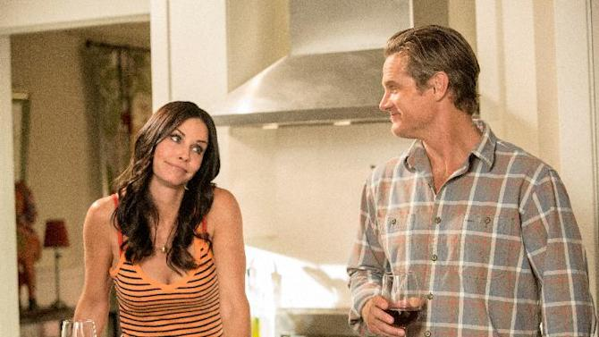 """This undated image released by TBS shows Courteney Cox, left, and Brian Van Holt in a scene from the fourth season of """"Cougar Town,"""" premiering Tuesday, Jan. 8, 2013 at 10p.m. EST on TBS. (AP Photo/TBS, Danny Feld)"""